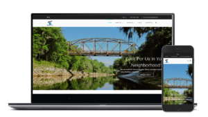 akins heating and air website on mobile and laptop