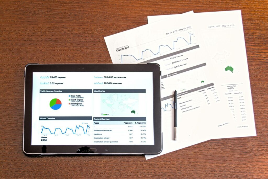 papers on desk showing marketing statistics